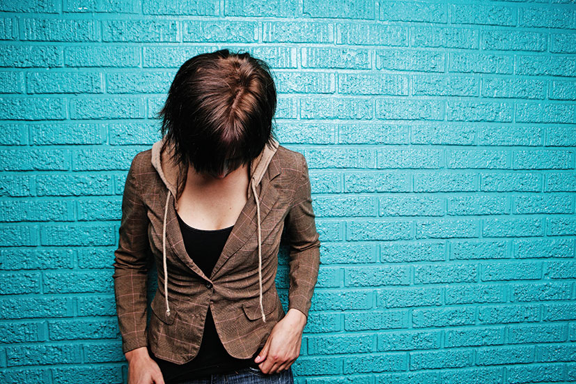 girl against turquoise wall